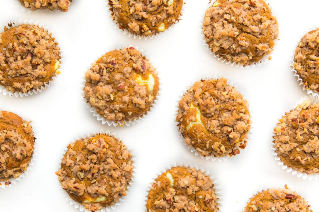 Broma Bakery | The Ultimate Pumpkin Muffins: luscious pumpkin muffins with a cheesecake center and almond streusel topping!