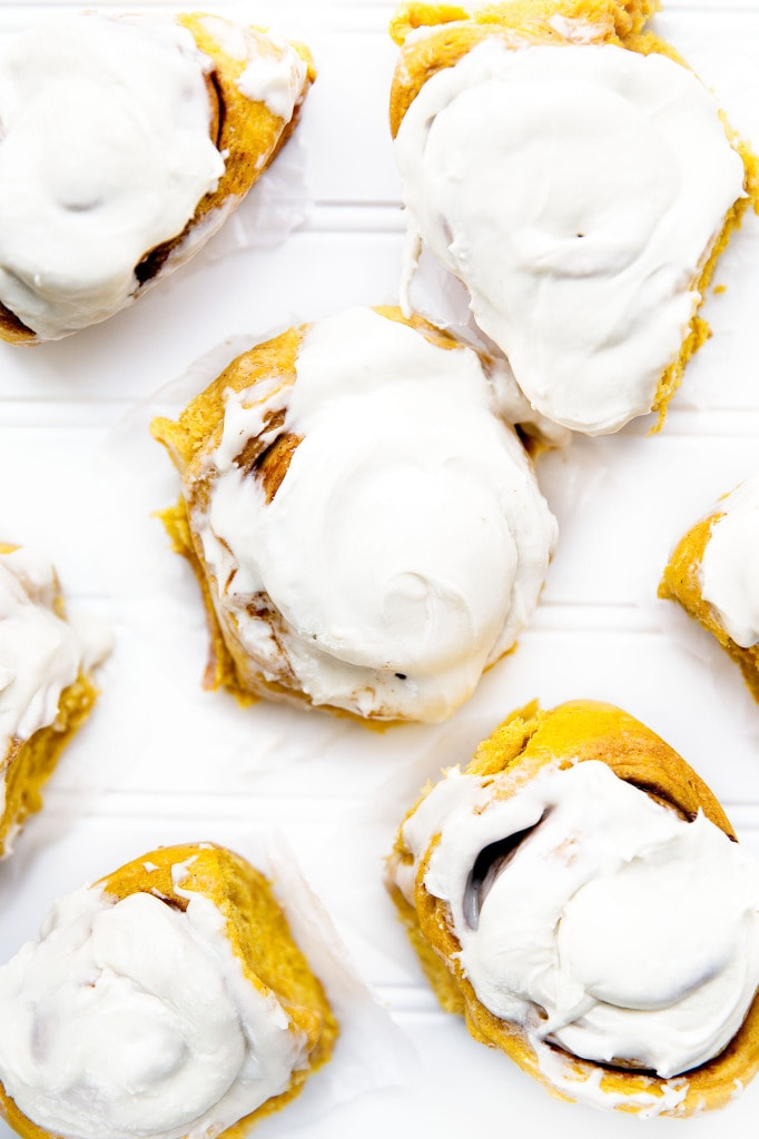 Soft, pillowy pumpkin cinnamon rolls topped with a tangy cream cheese frosting. Perfect for a weekend breakfast! | via Broma Bakery | #stickybuns
