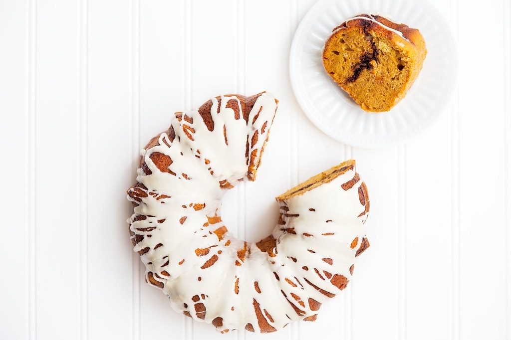 A spiced sweet potato bundt cake with pecan streusel and topped with a maple syrup glaze | via Broma Bakery | #sweetpotato #bundtcake