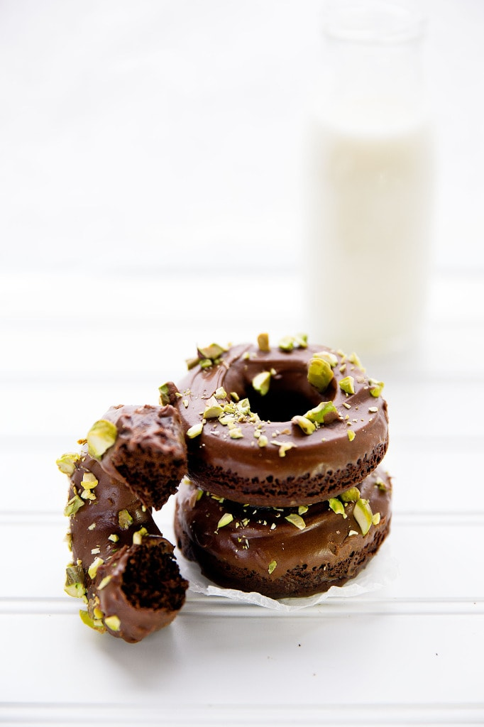 Baked Double Chocolate Donuts with a chocolate glaze and crushed pistachios | Broma Bakery