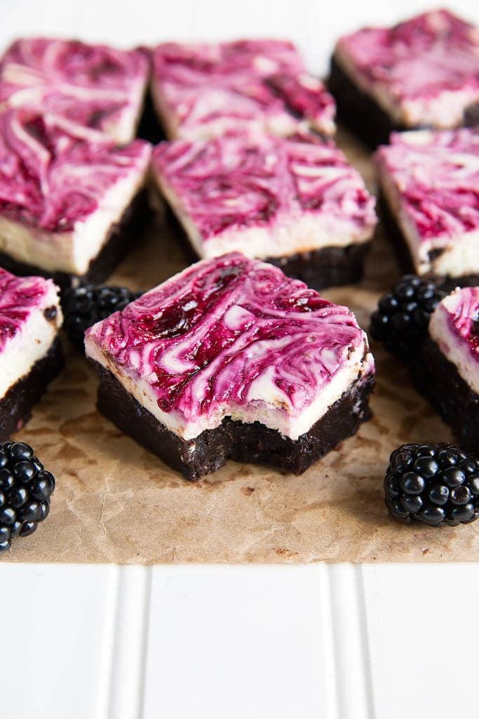 Blackberry cheesecake brownies on a cutting board