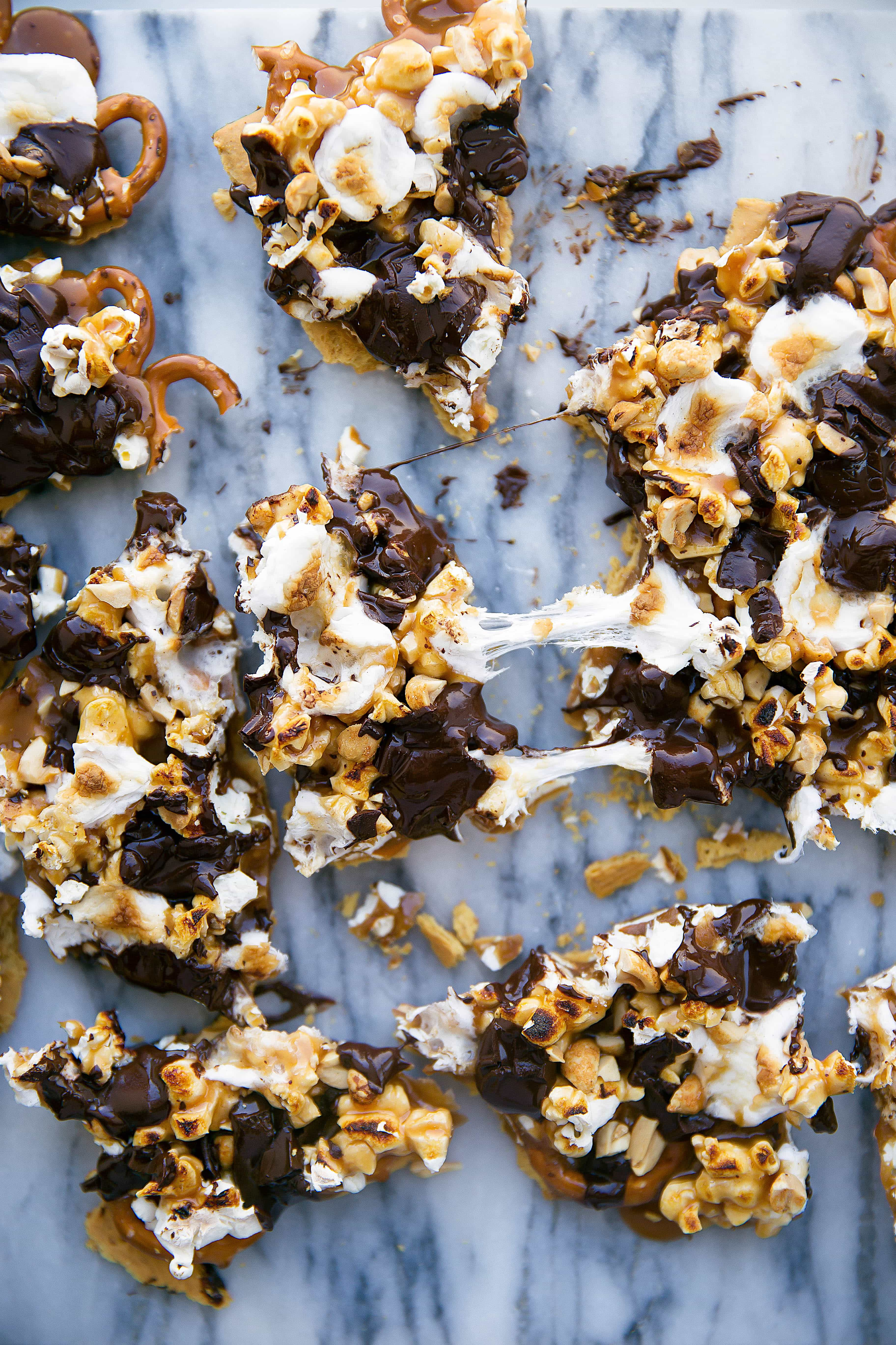 This loaded bark is made with graham crackers, pretzels, peanuts, toffee, popcorn, chocolate, and toasted marshmallows. Betcha can't eat just one!