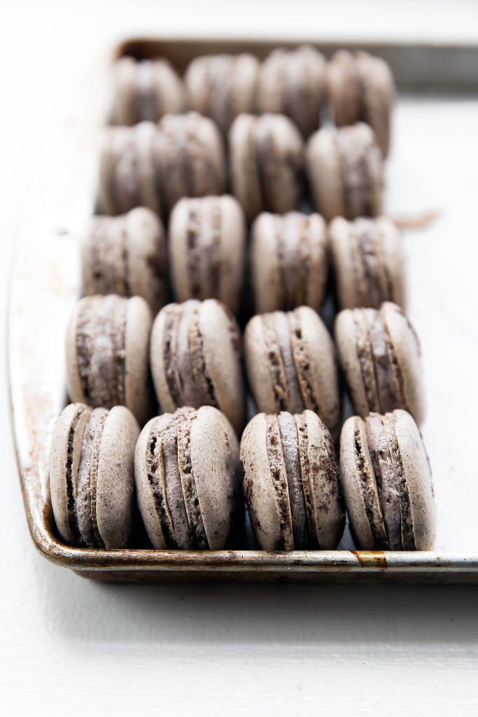 cookies and cream macarons on a baking tray
