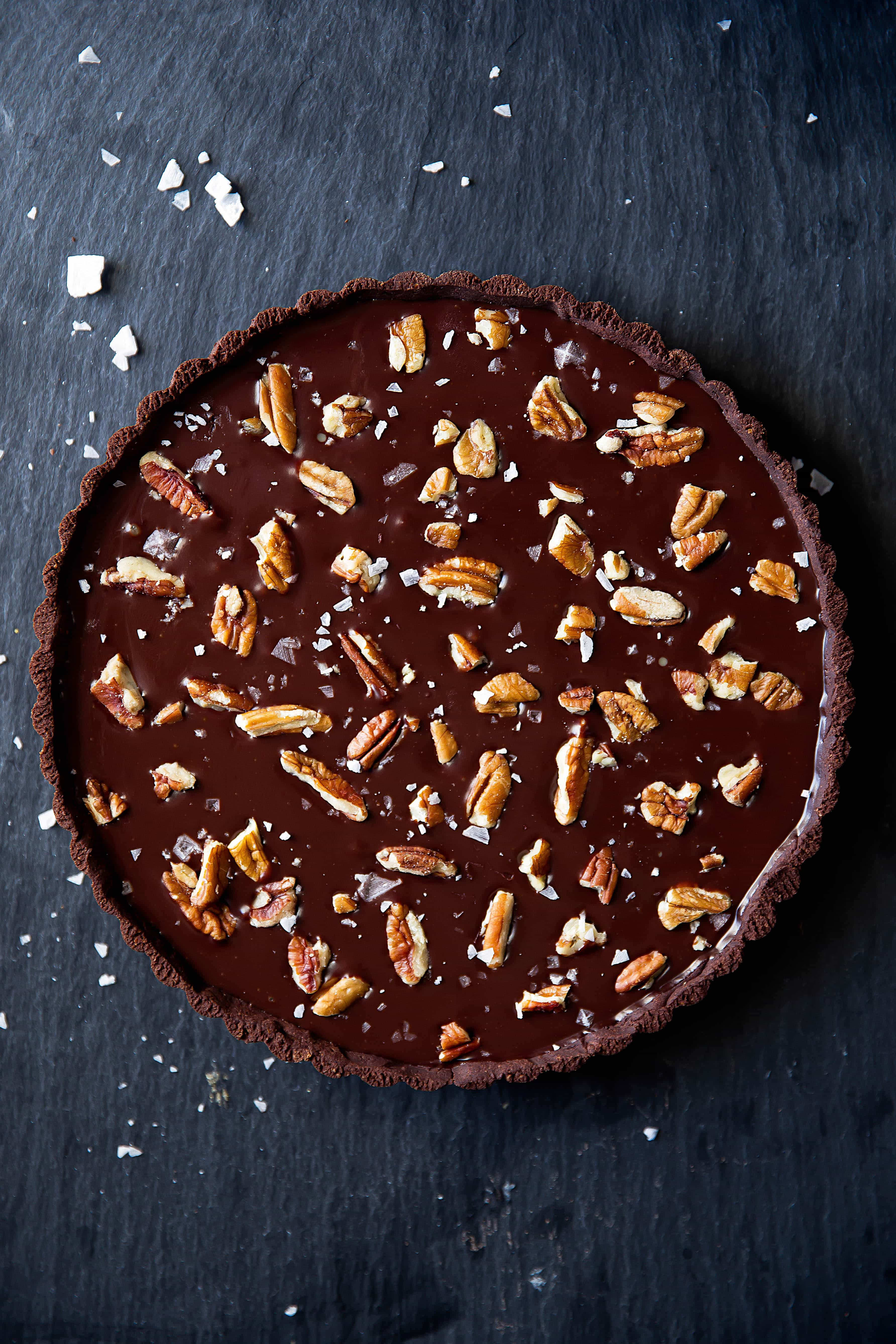 Salted Caramel Chocolate Tart has a chocolate pretzel crust, salted caramel center, and is topped with melted chocolate, pecans, and sea salt. Uhm, swoon?!