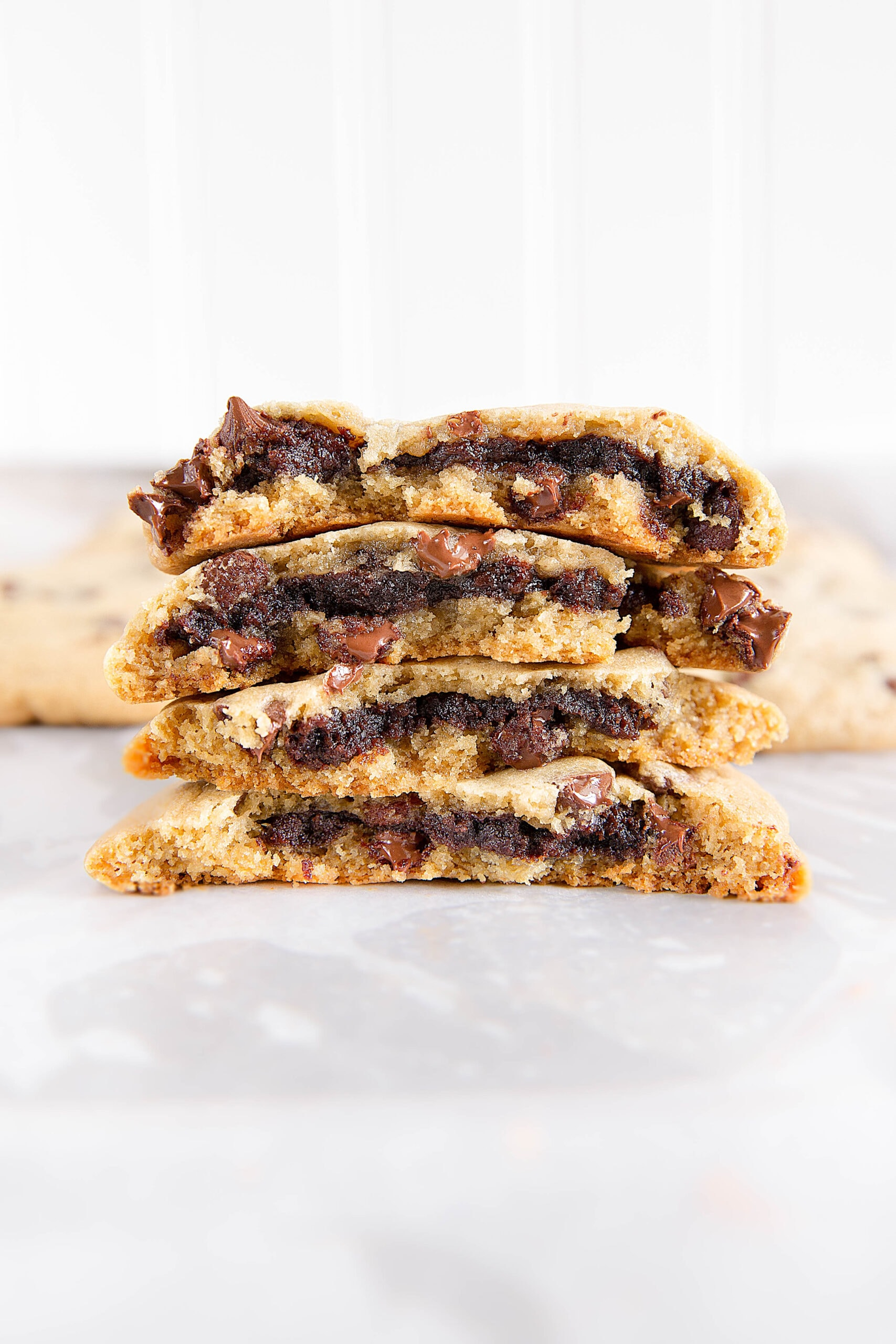 Brownie stuffed chocolate chip cookies combine the best of both worlds- a fudgy brownie center and soft and chewy chocolate chip cookies! These babies are dangerously good.