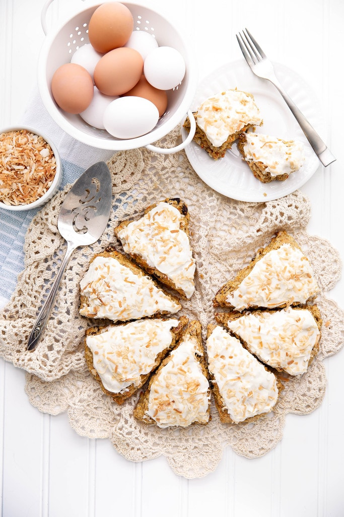 Moist and delicious Carrot Cake Scones topped with a sinful coconut cream cheese frosting are a perfect weekend breakfast!