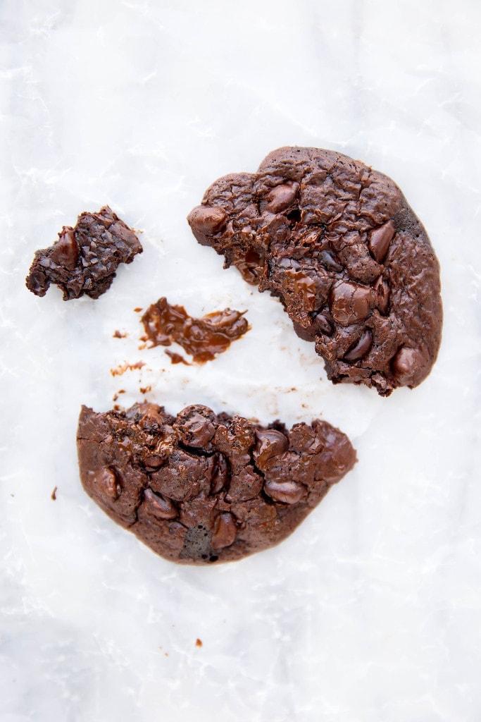 Flourless chocolate cookie broken in half