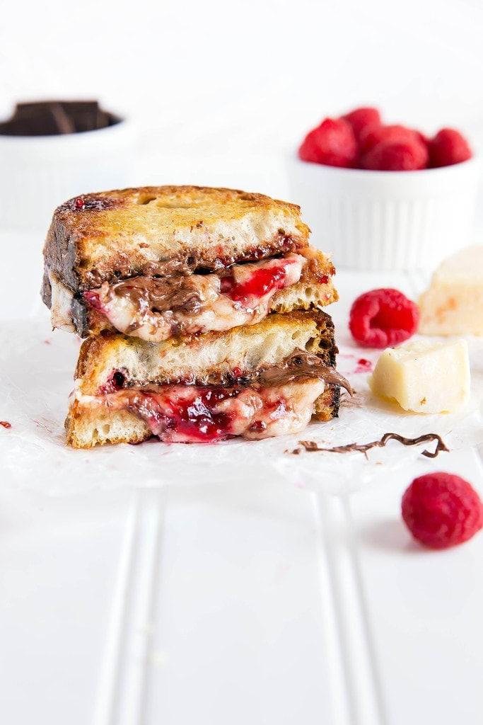 Nutty Havarti cheese is paired with Nutella and raspberry jam to make the tastiest grilled cheese I've ever had!