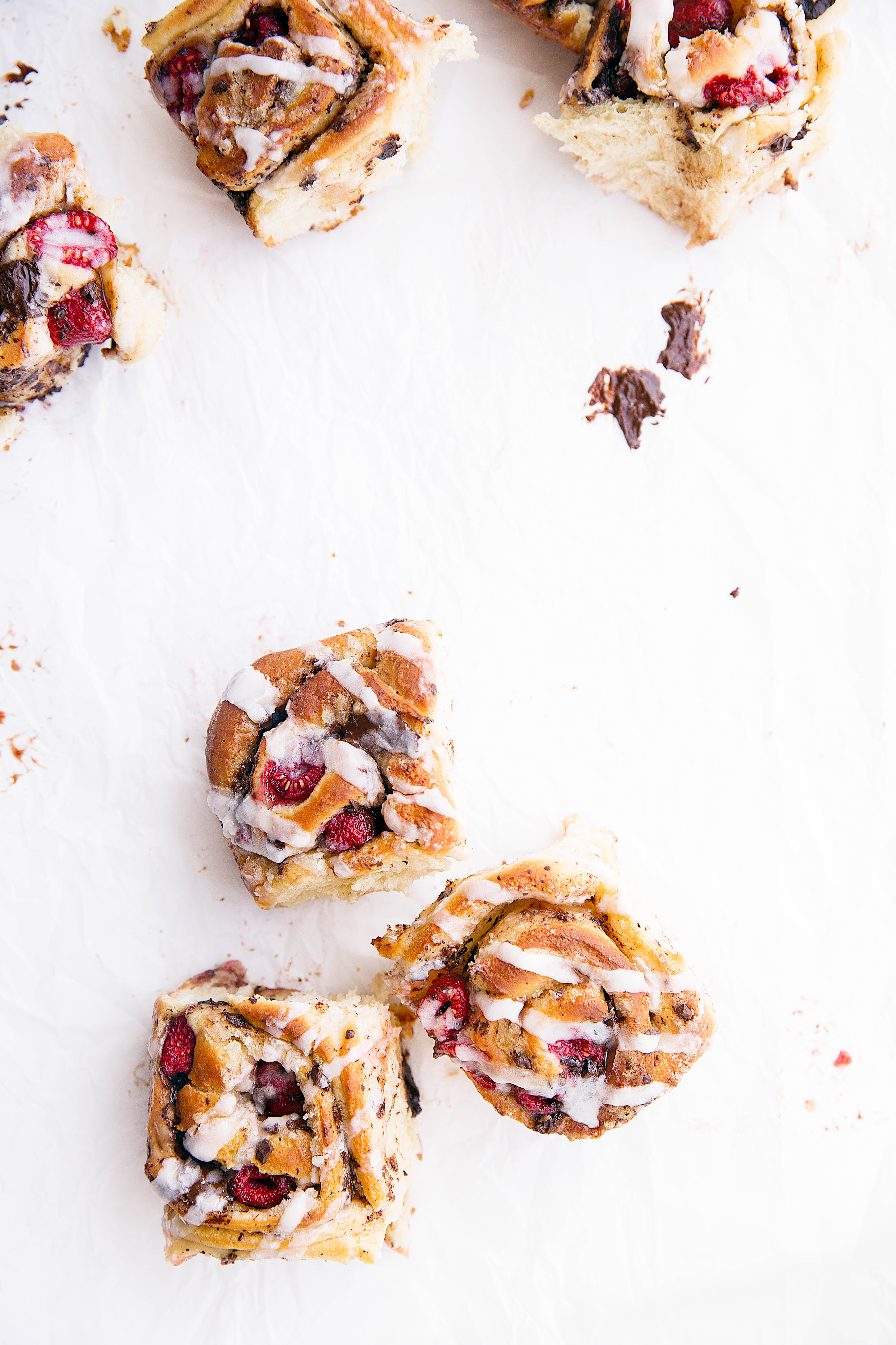 Pieces of dark chocolate and plump raspberries are tucked inside the most light and chewy dough in these Dark Chocolate Raspberry Sticky Buns. Quite possibly the best buns I've ever had!