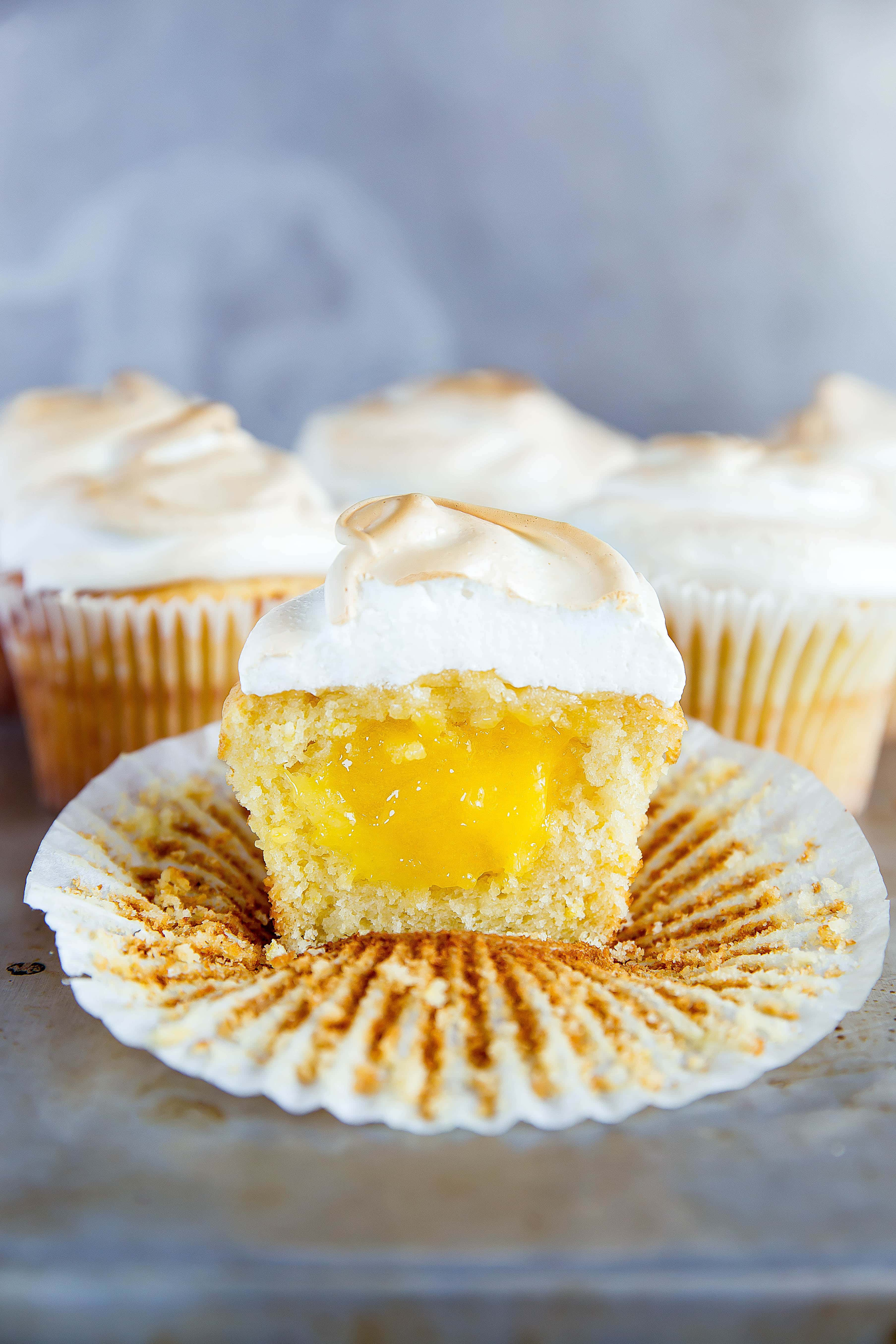 Lemon Meringue Cupcakes: fluffy lemon cupcakes filled with lemon curd and topped with a perfectly golden meringue frosting! Are you drooling yet?