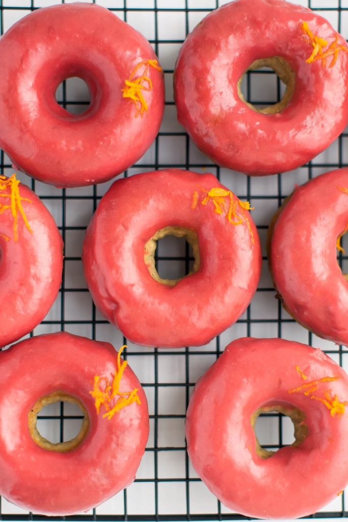 Baked Rhubarb Orange Glazed Donuts: soft and fluffy rhubarb donuts flavored with orange and dipped in a tangy rhubarb glaze!