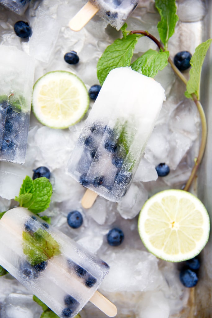 ... your booze on with these thirst-quenching Blueberry Mojito Popsicles