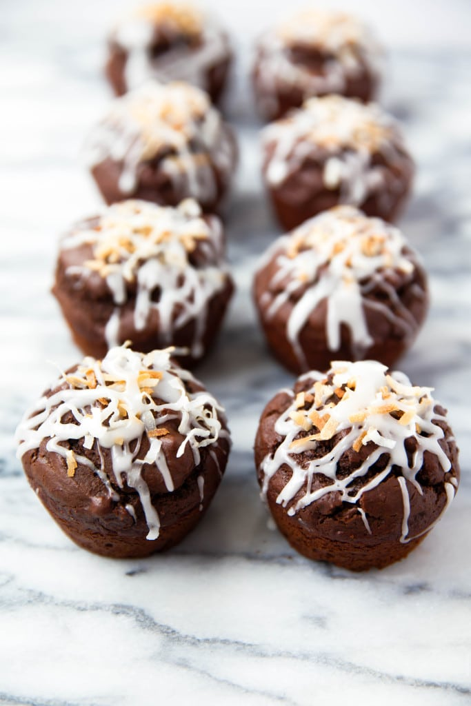 Fluffy Double Chocolate Coconut Muffins made with coconut oil and topped with a coconut drizzle!