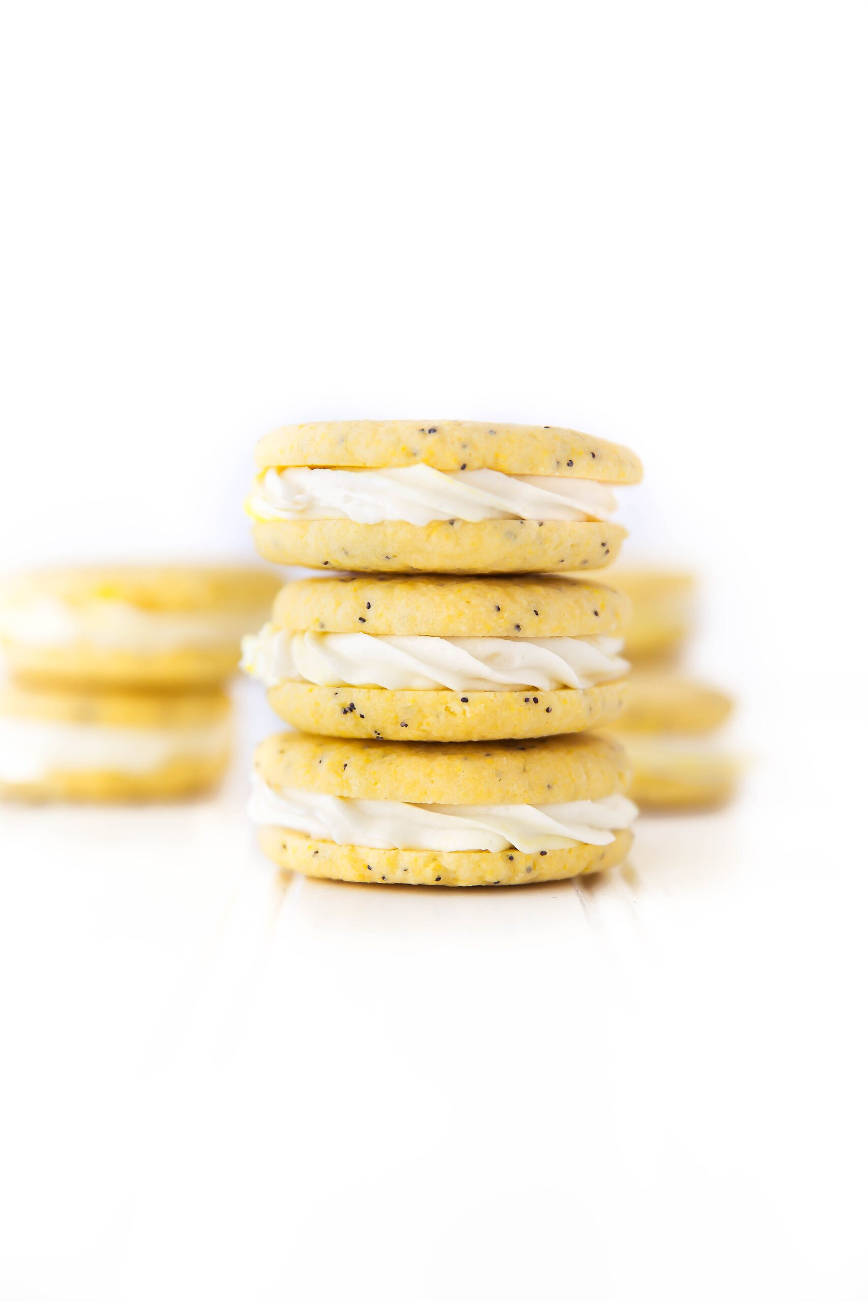 Lemon Poppy Seed Sandwich Cookies: the most addicting lemon cookie I've ever had, period!