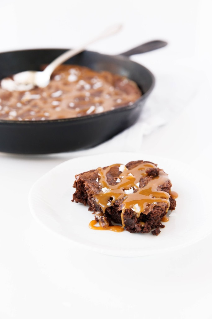 Salted Caramel Skillet Brownie: the fudgiest brownie laden with homemade salted caramel and baked in a caste iron pan!