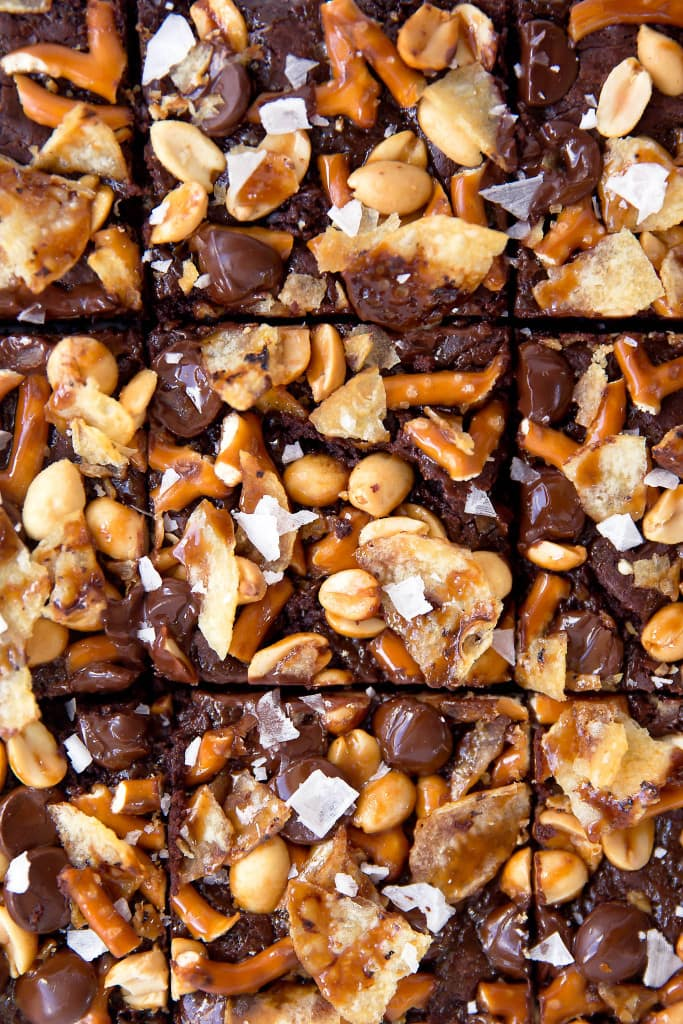 When you're hungry, The Munchies Brownies got you covered: fudgy brownies topped with a sweet and salty combination of pretzels, peanuts, chocolate, potato chips, and sea salt!