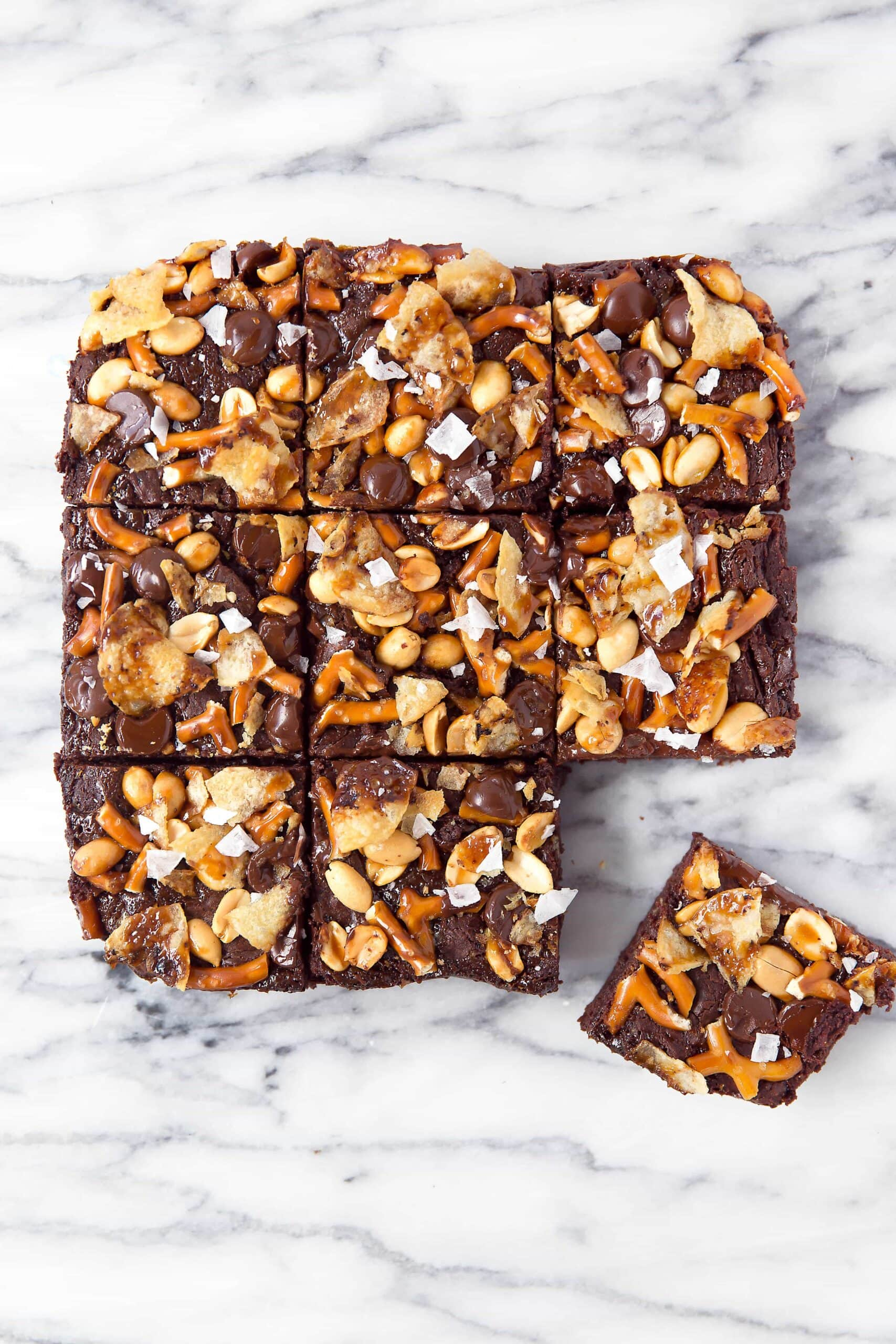 When you're hungry, The Munchies Brownies got you covered: fudgy brownies topped with a sweet and salty combination of pretzels, peanuts, chocolate, potato chips, caramel, and sea salt!