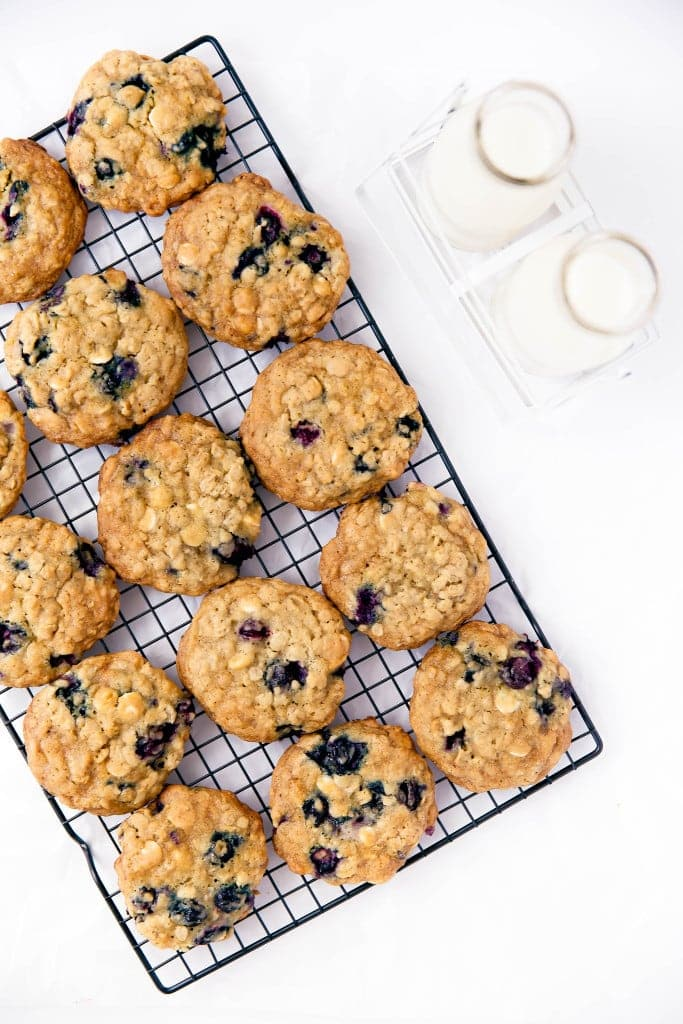 white chocolate blueberry oatmeal cookies on wire rack