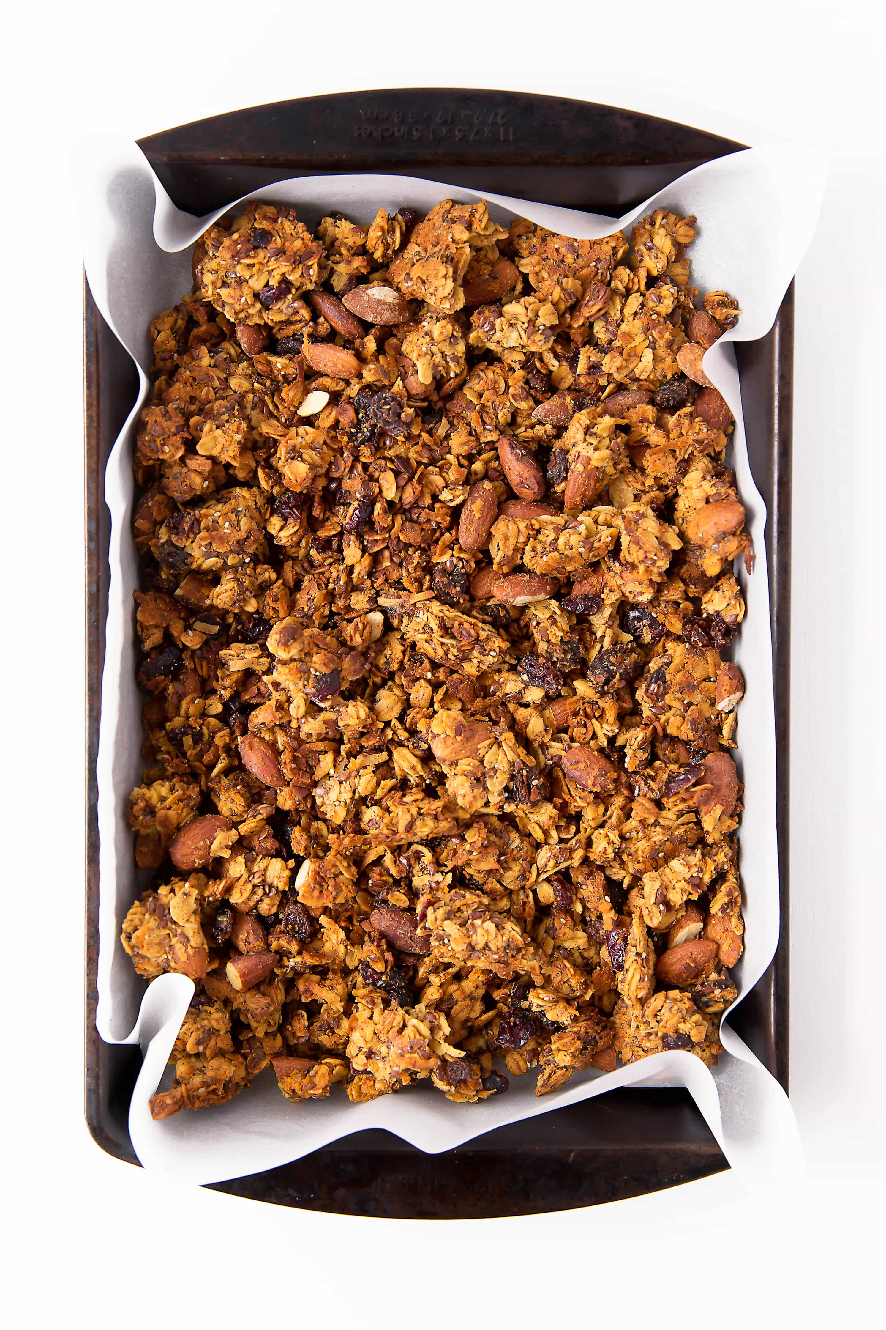 Packed with carrots, coconut, cinnamon, and raisins, this Carrot Cake Granola takes breakfast up a notch. Gluten free, refined sugar free, and loaded with ingredients that will keep you full all morning long.