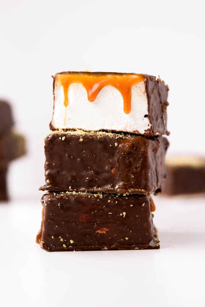 We're taking campfire treats to the next level with these S'mores Marshmallows: silky homemade marshmallows topped with salted caramel and covered in dark chocolate & graham cracker crumbs. Yes, please!