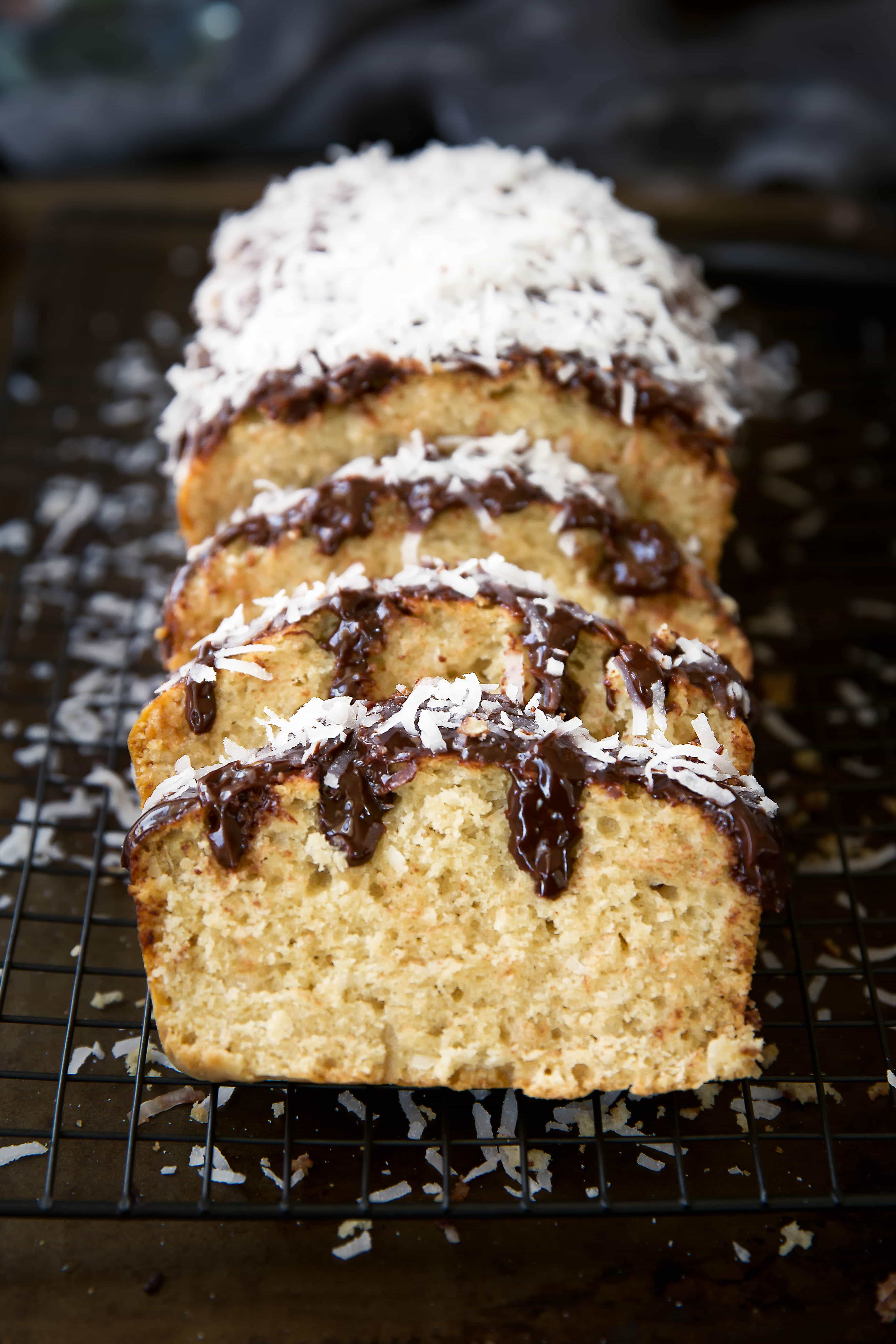 One hour is all it takes for this moist coconut loaf drizzled with chocolate ganache and shredded coconut!