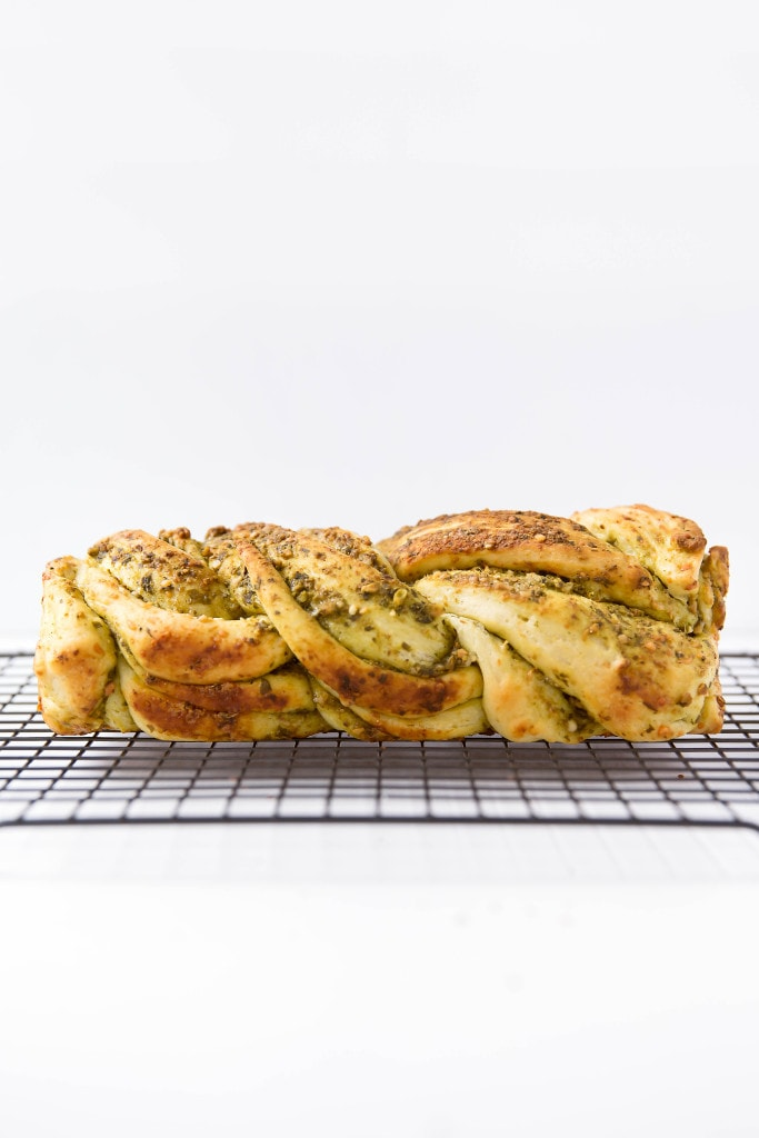 loaf of Parmesan Pesto Bread on a wire rack
