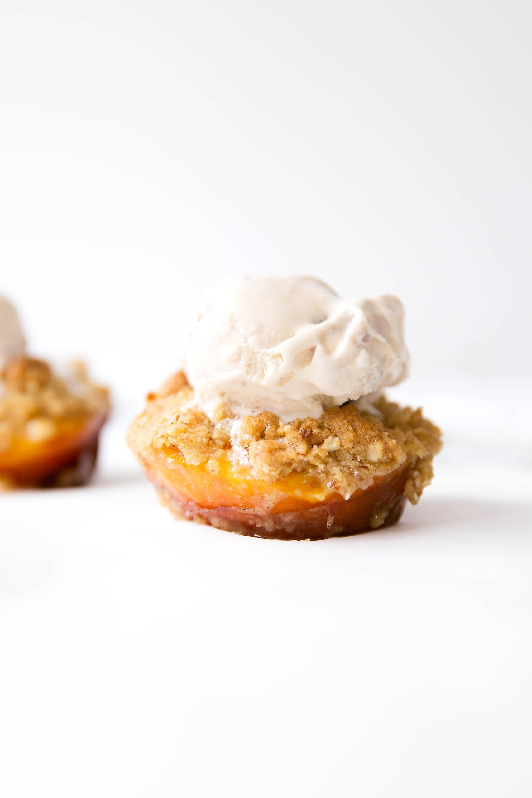 Perfectly roasted peaches with an addicting oatmeal almond crumble