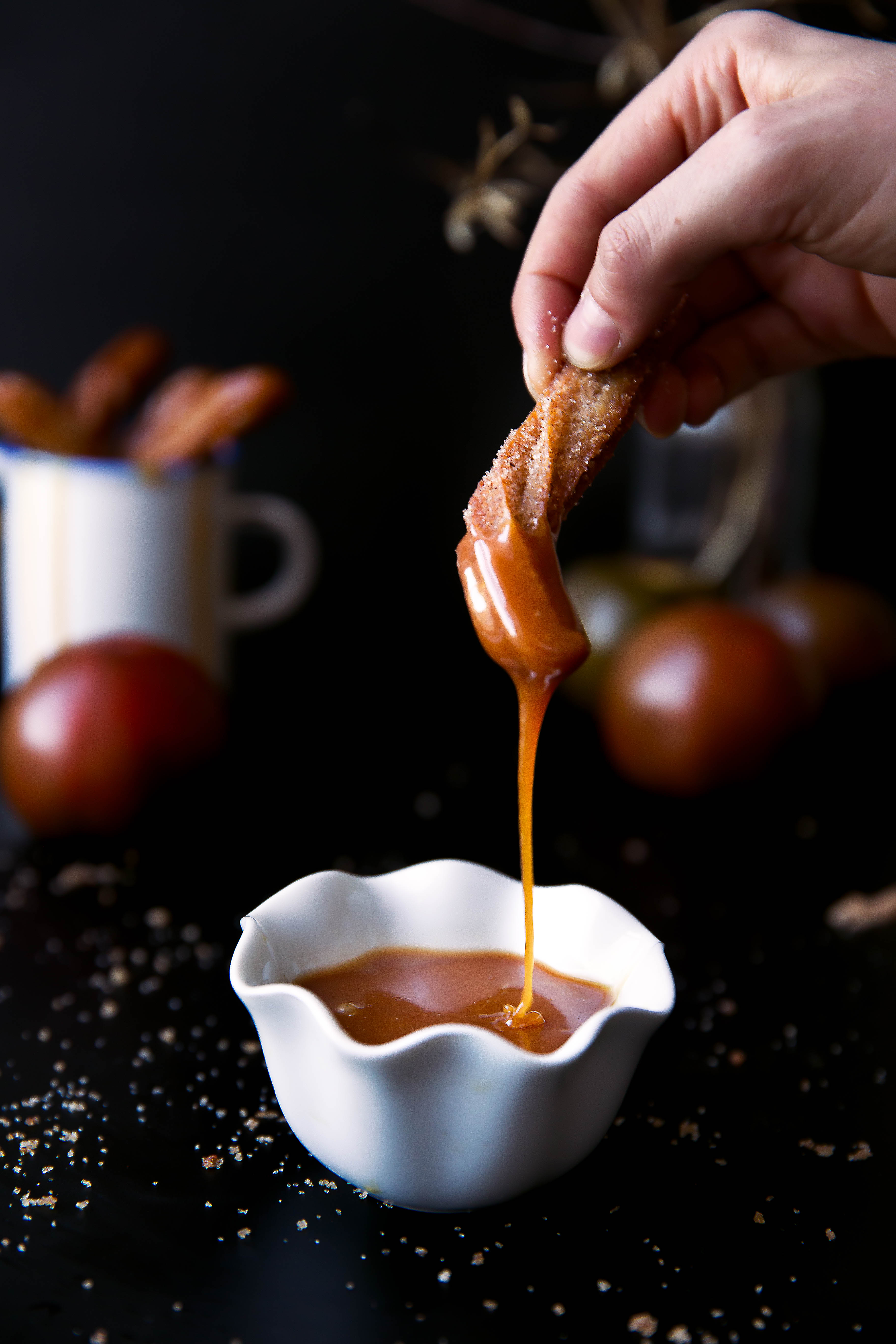 Just in time for fall: light and airy apple cider churros with salted caramel sauce perfect for dunking!