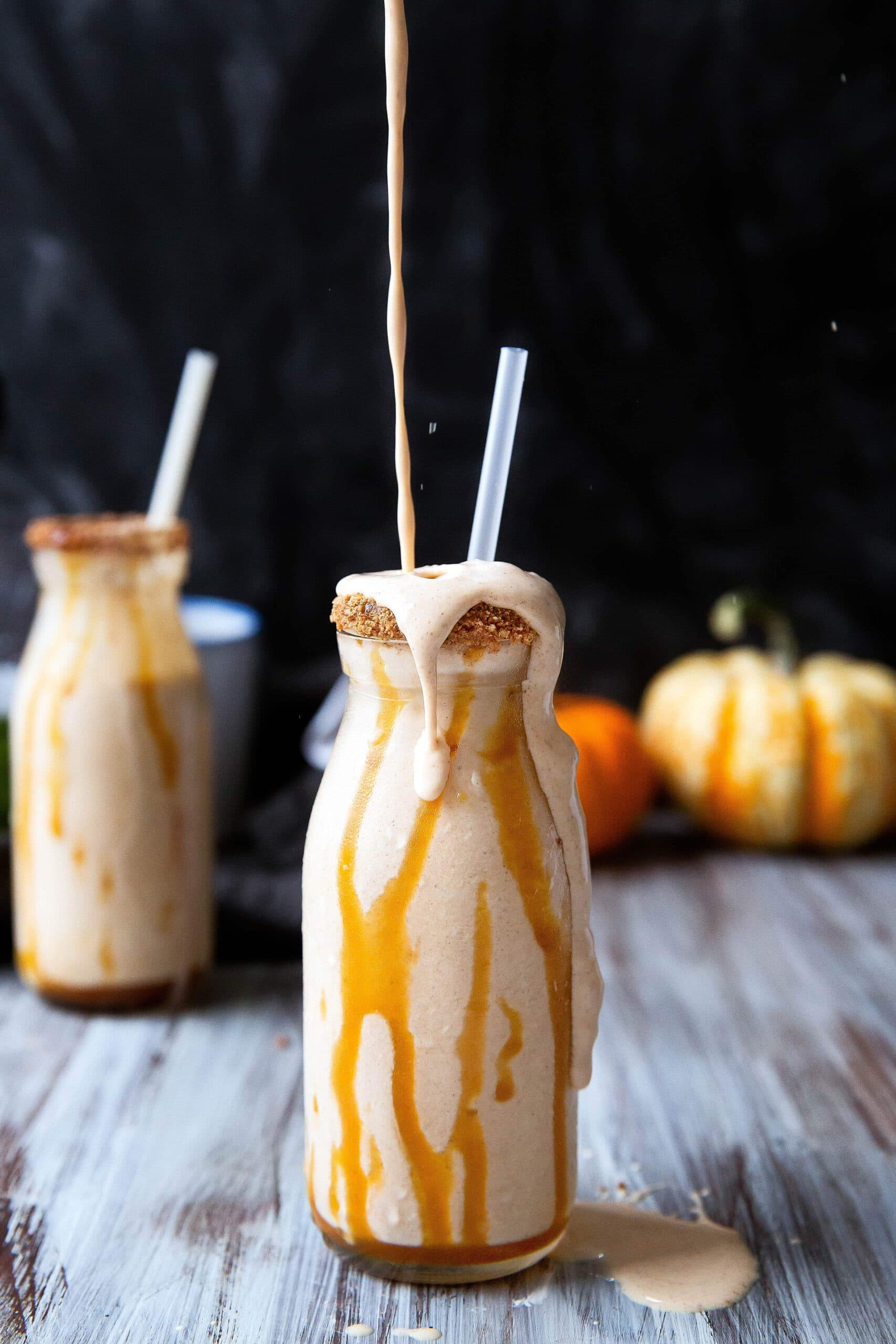 A ridiculously easy boozy pumpkin milkshake with graham, caramel, and bourbon. Hello holiday entertaining!