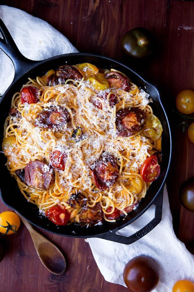 spaghetti with tomato cream sauce in a skillet
