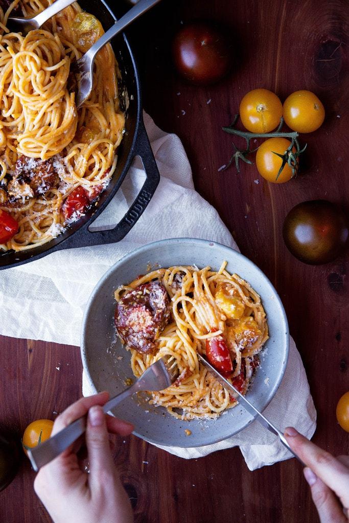 spaghetti with tomato cream sauce in a bowl