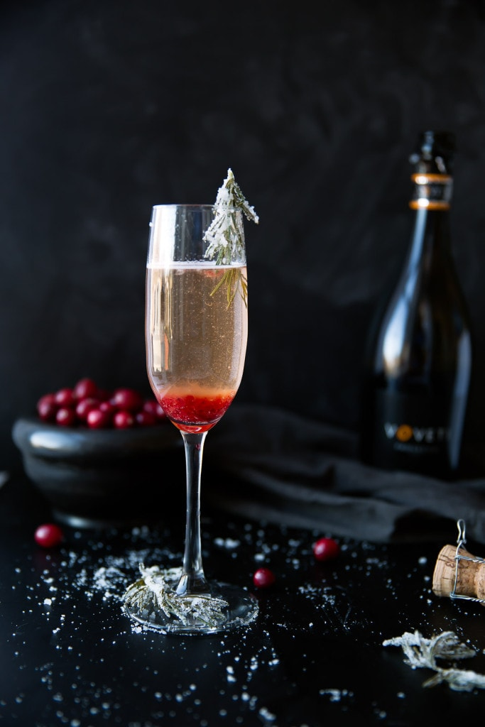 Cranberry Orange Prosecco Cocktail with candied rosemary
