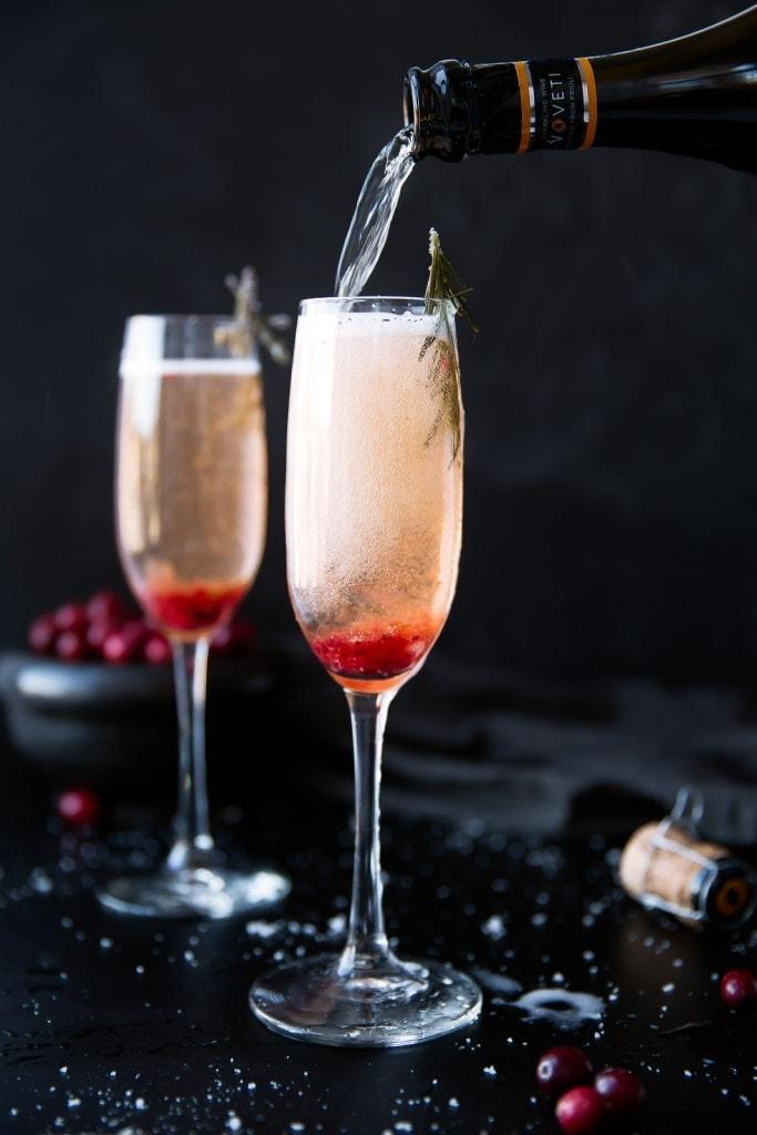 pouring a Cranberry Orange Prosecco Cocktail