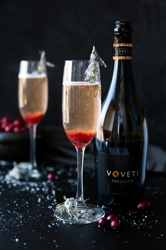 Almost as beautiful as it is easy, this Cranberry Orange Prosecco Cocktail with candied rosemary is sure to please!