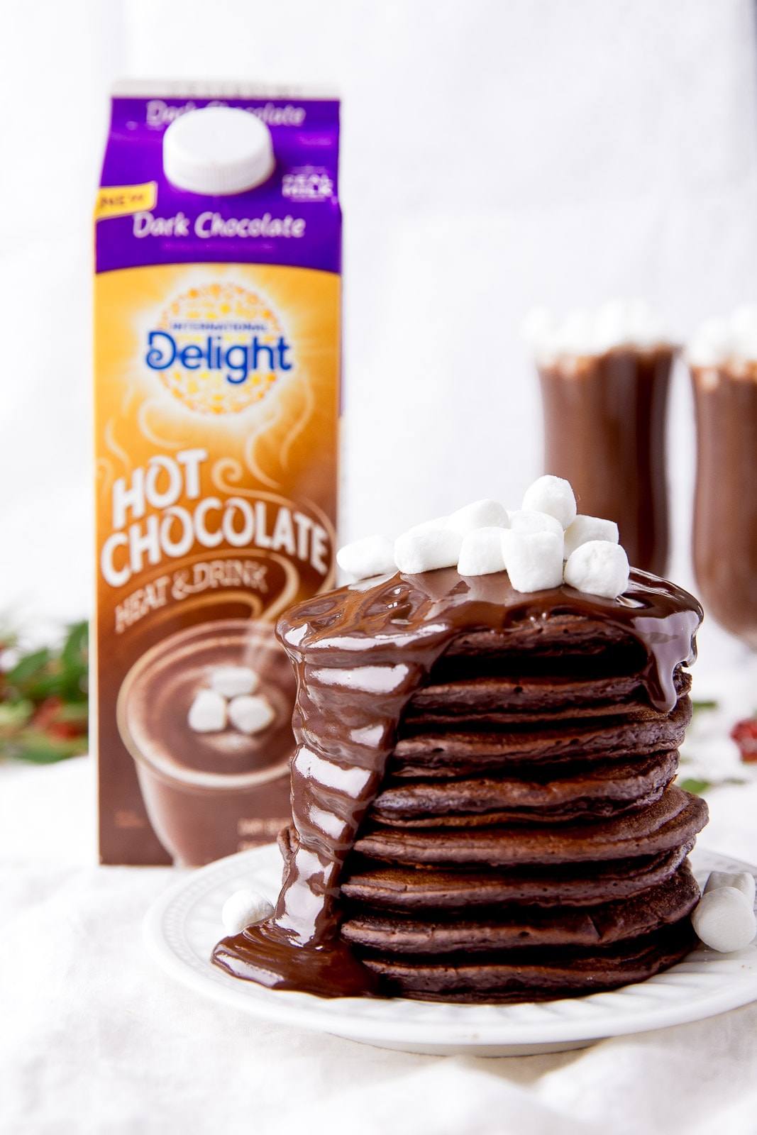 Hot Chocolate Pancakes with fudge sauce