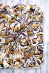 A festive dark and white chocolate bark with golden accents perfect for New Year's Eve!