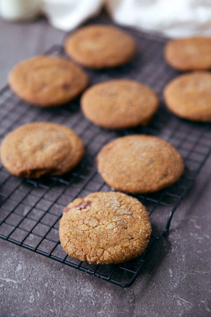 gingersnap cookies on a cooling rack