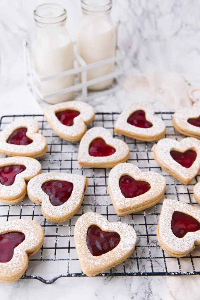 cherry linzer cookies on a wire rack