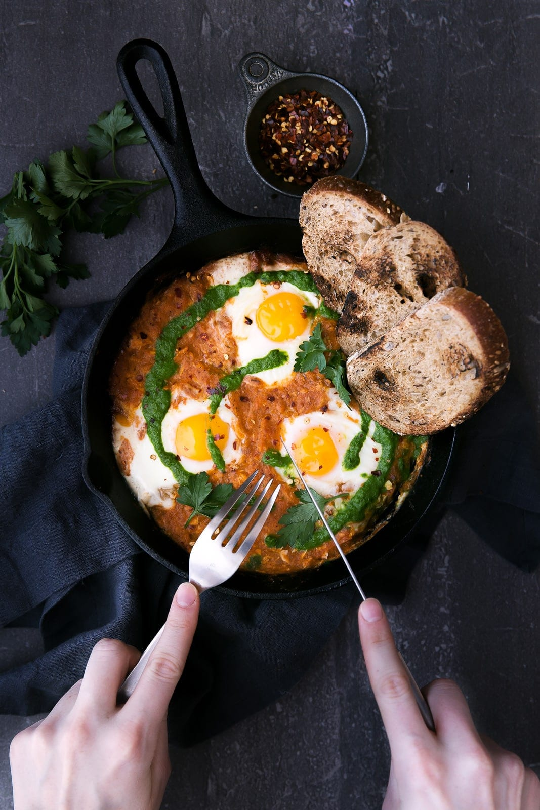 Say hello to shakshuka for breakfast: perfectly poached eggs in a spiced tomato sauce!