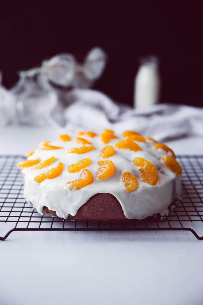 Coconut Lemon Cake with coconut cream icing and mandarin oranges