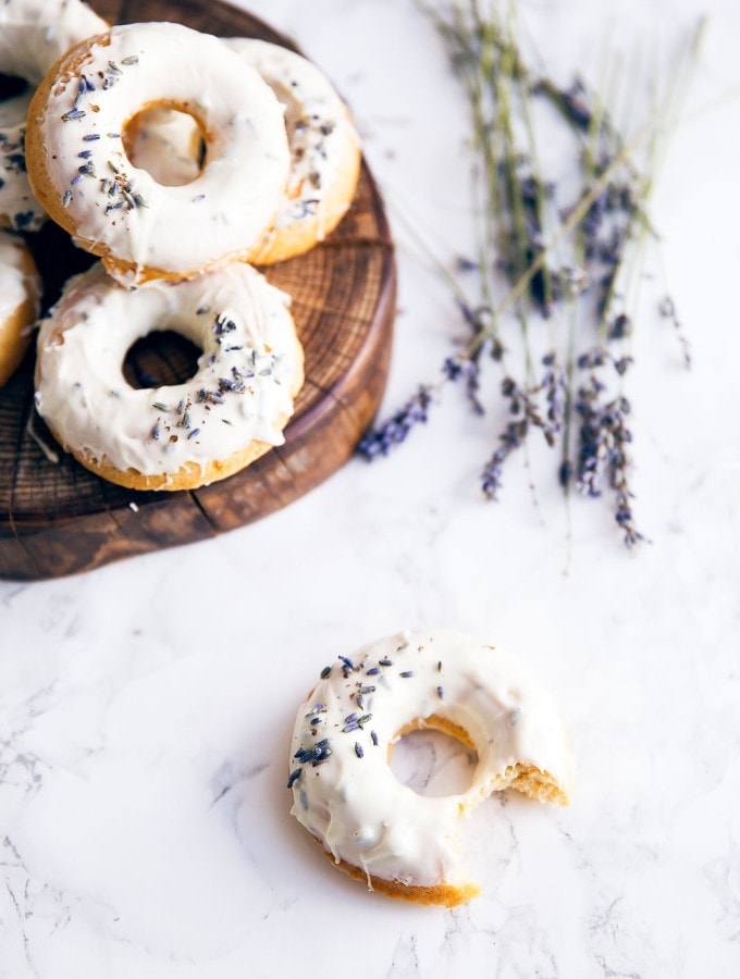 Celebrate spring with baked lemon donuts dipped in a lavender-infused white chocolate ganache!