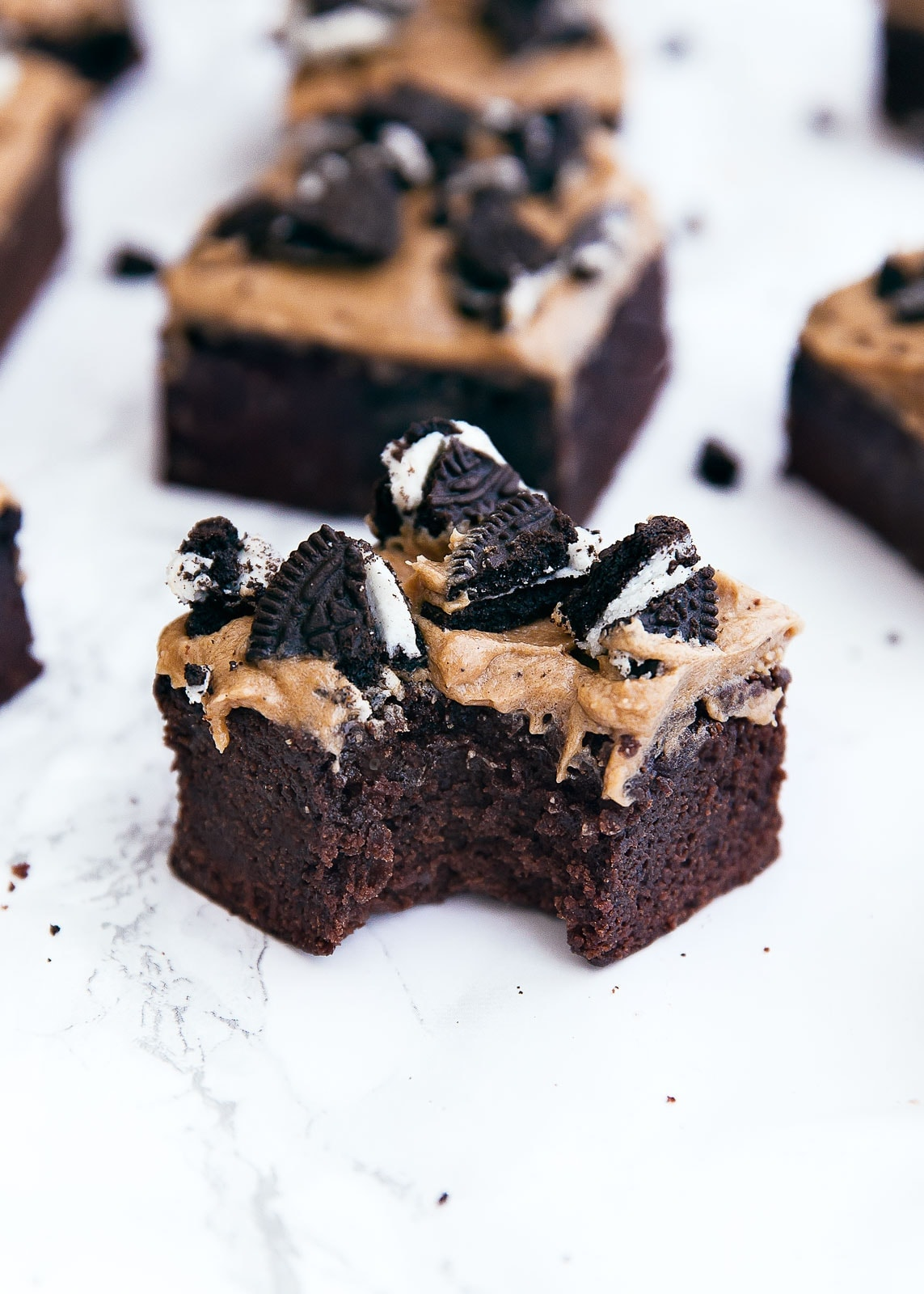 A thick mocha brownie topped with coffee buttercream and crumbled oreos. Is this what heaven tastes like? I think so.