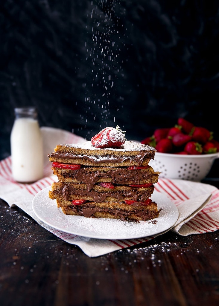 Strawberry Nutella French Toast being dusted with powdered sugar