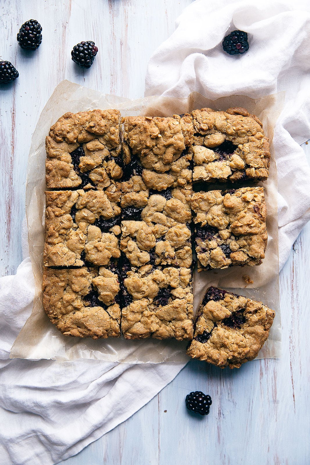 Chewy oatmeal bars with a homemade blackberry jam center and crumble topping