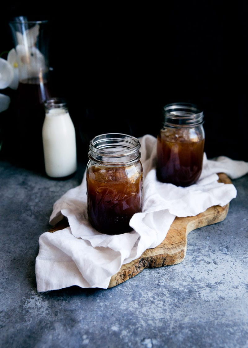 two glasses on homemade cold brew coffee on a board