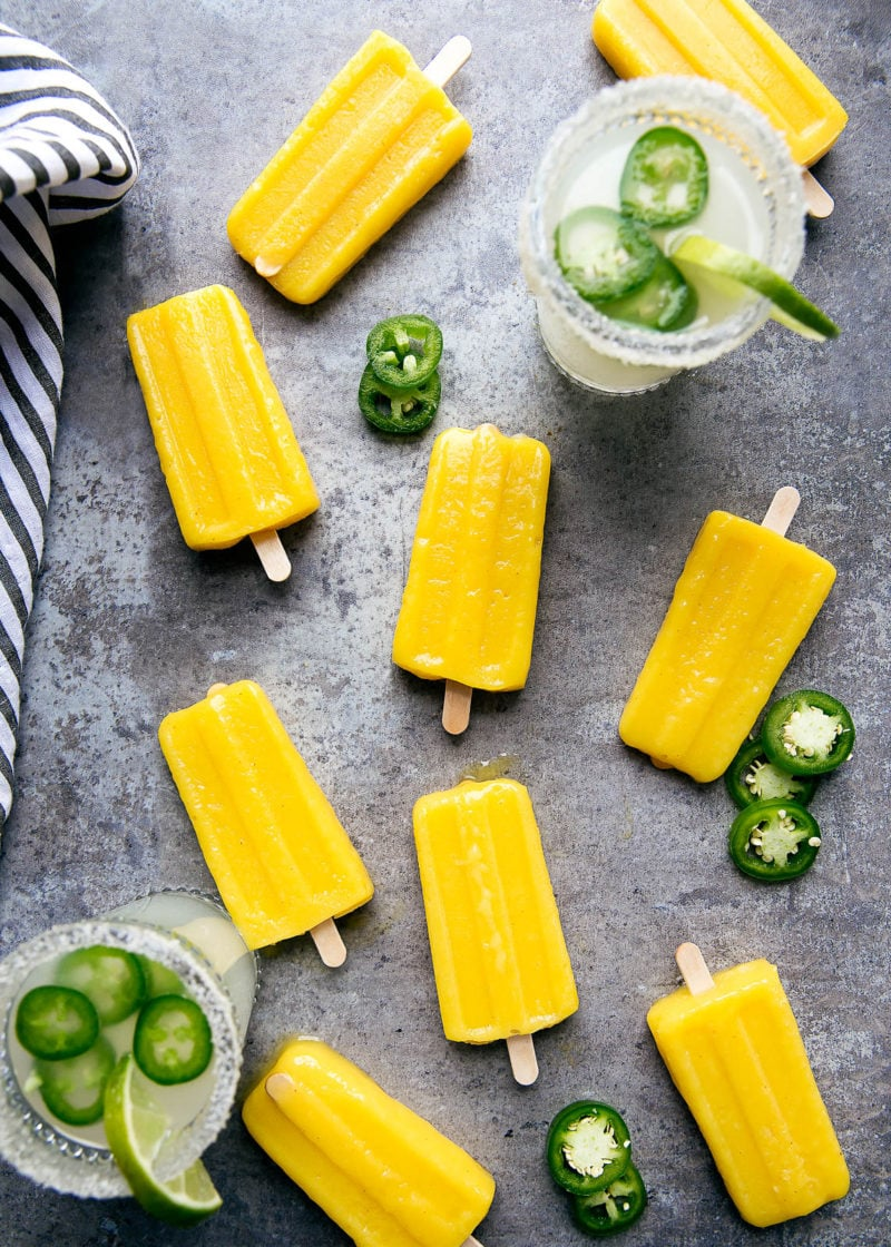 Forget ice cubes, we're dipping Jalapeño Mango Margarita Popsicles into our drinks! Perfect for Cinco de Mayo!