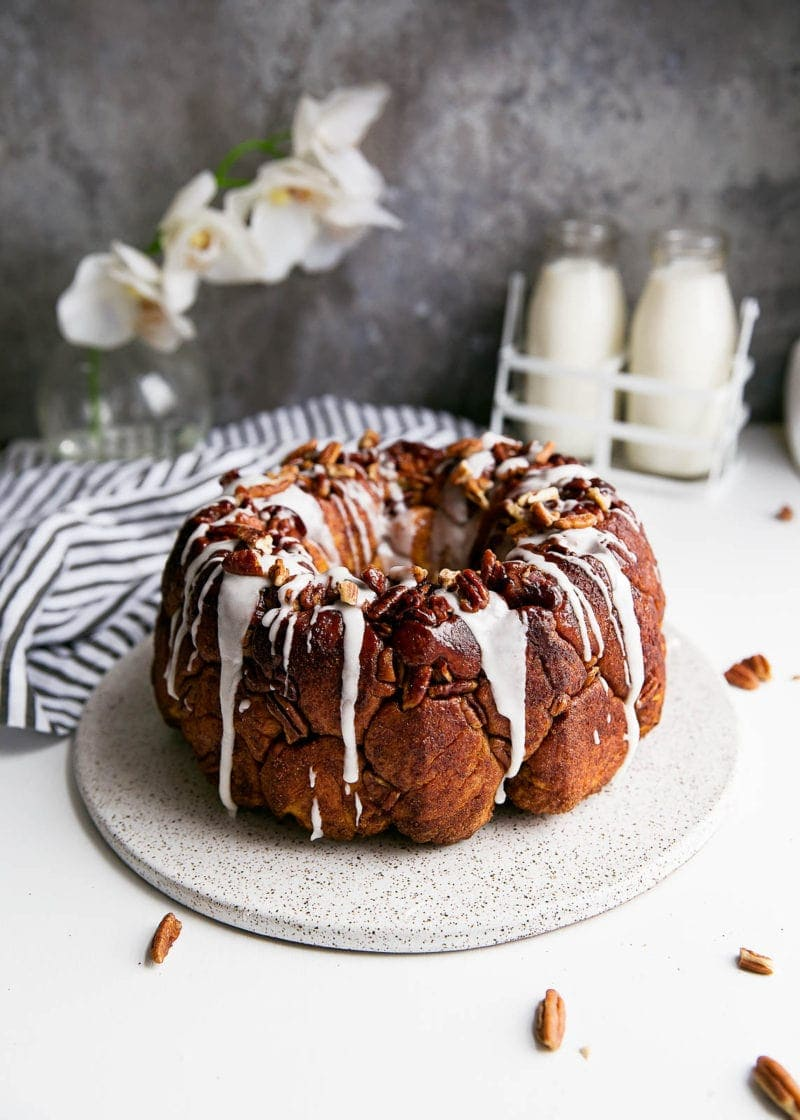 A soft and pillowy buttered rum monkey bread covered in cinnamon sugar, pecans, and topped with rum icing. So, like, can I have this every weekend?