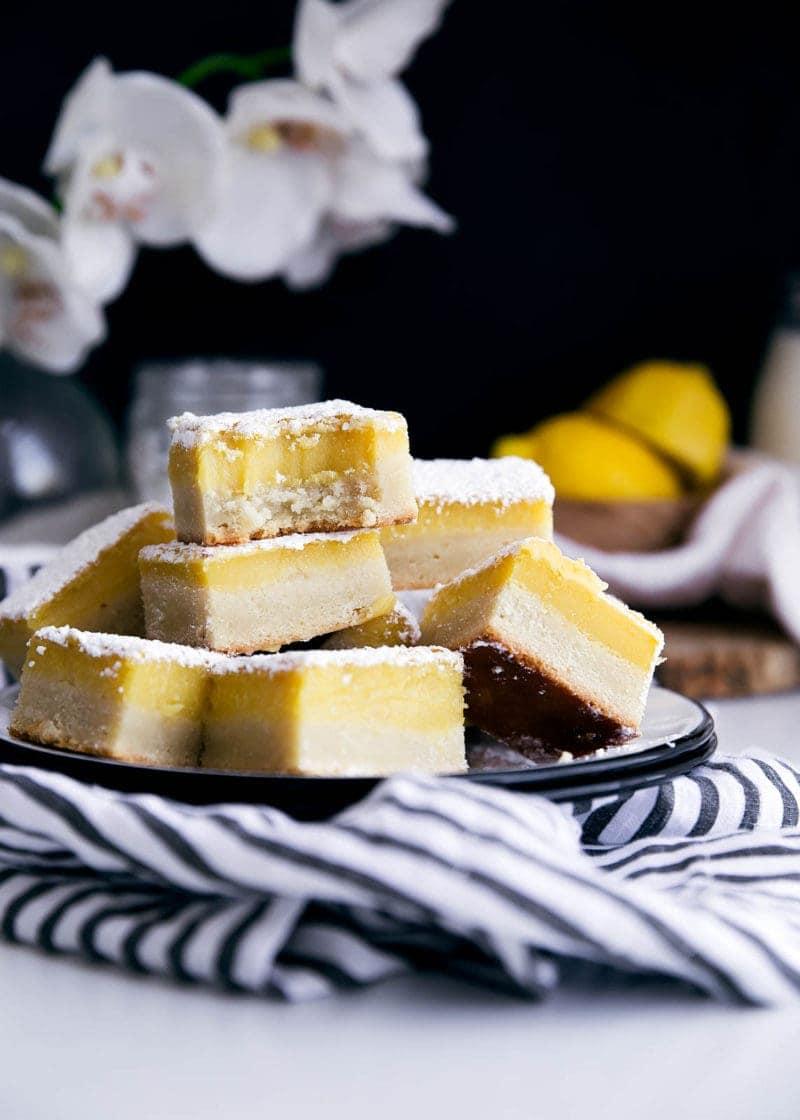 stack of ginger lemon bars on a plate