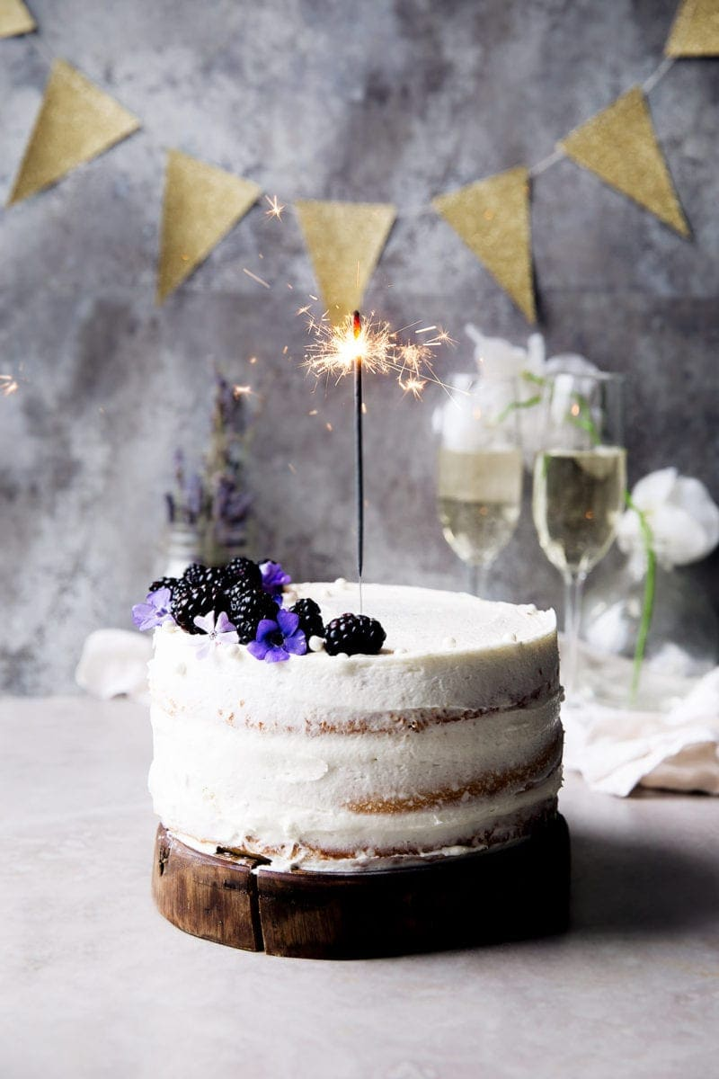 A soft vanilla cake layered with raspberry jam and vanilla CHAMPAGNE FROSTING. Let's get this party started.
