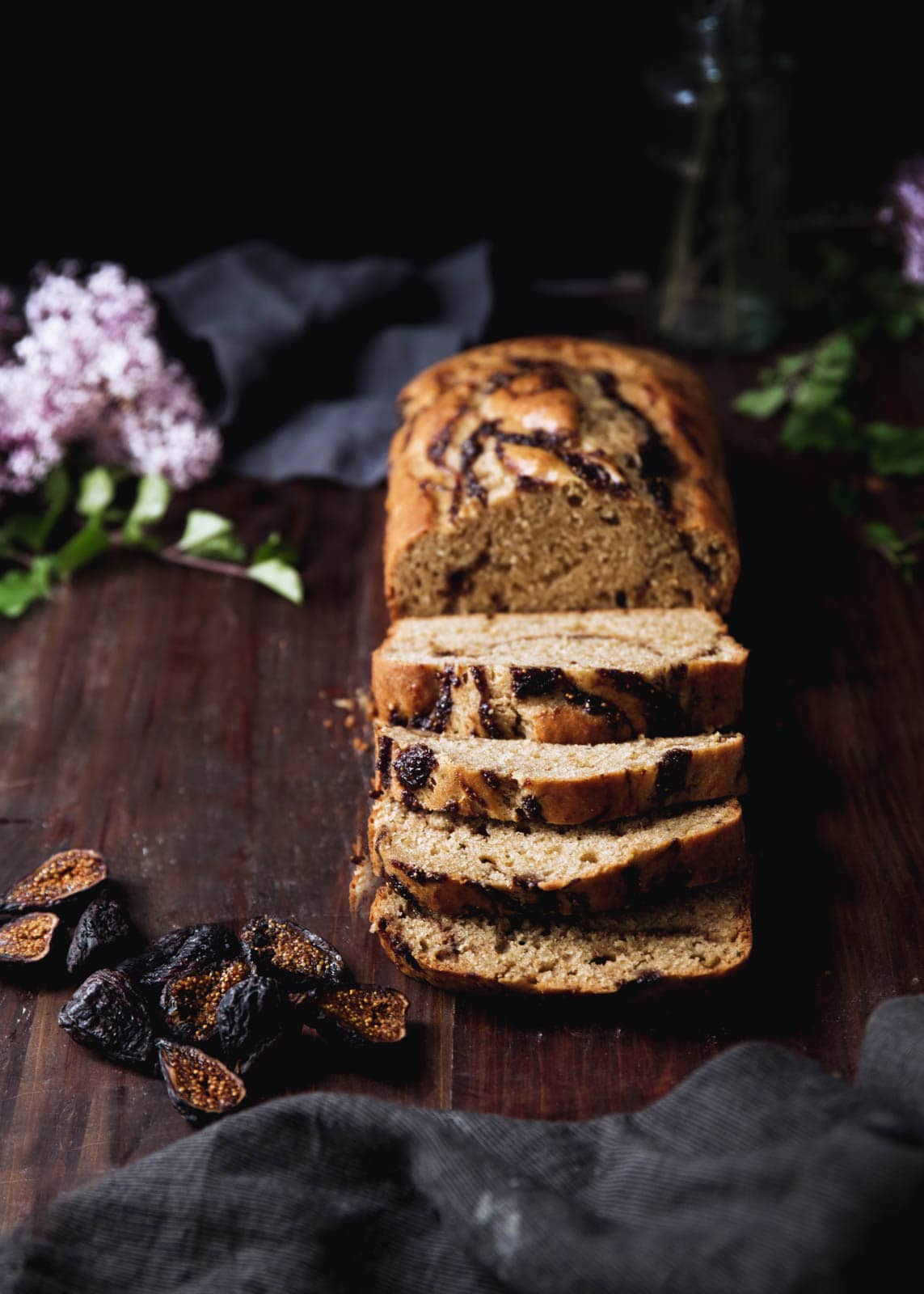bourbon fig banana bread on a wood board